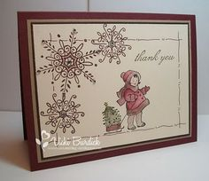 I like the muted colors she used and the way she framed in the card using the snowflake and hand drawn lines.