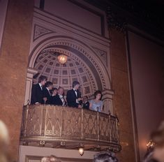 """The Beatles attend the Liverpool premiere of their movie """"A Hard Day's Night,"""" at the Odeon Cinema in their hometown, July 10, 1964. With them are the Mayor and Lady Mayoress of Liverpool. From left: George Harrison, John Lennon, Ringo Starr, Lord Mayor Louis Caplan, Lady Mayoress Fanny Bodeker. (AP Photo)"""