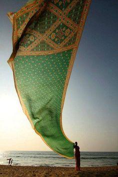 Woman drying her sari, Orissa, India