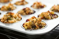 Make these Vegan Stuffing Muffins for your Thanksgiving feast. - 1 stale loaf sourdough bread, cubed - 2 tablespoons olive oil - 1 large onion, chopped - 3 small apples, chopped - 4 ribs celery, chopped - ½ cup parsley, chopped - 2 tablespoons sage, chopped - 2 tablespoons thyme, chopped - 2 tablespoons rosemary, chopped - 3/4 cup dried cranberries - 2 teaspoons salt - 1 teaspoon pepper
