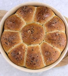 Flower rolls with caraway and onion seeds, baked in a cloche.