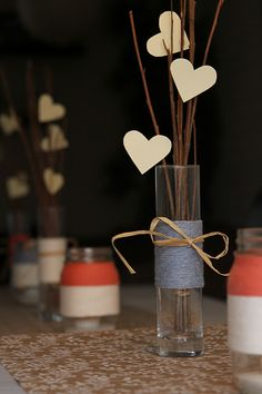center pieces; do the sticks longer and bend them towards the top, so they hang out in different directions like fishing poles, and hang the paper hearts by fishing line.