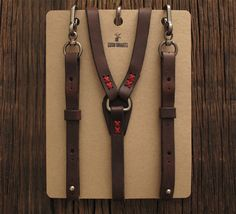 Made rugged for the outdoors. Wear them in the city only to prove you'd rather be in the woods. Adjustable holes are numbered for easy custom fitting with hefty clips fastening easily and securely to your belt loops. Hand-manufactured from thick leather, waxed cord stitching, and heavy-wear clips (belt loop attachment). 100% Genuine Leather and Solid Brass Fastenings Handmade in the USA