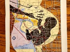 Pen and ink on a map of Buffalo, NY, with sections cut out with a razor. (Photo: ~Courtesy of Dan Landau)