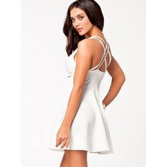 0628158635 The features for this short little white dress include  strappy back