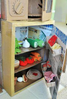 DIY Cardboard Play Kitchen – Craft projects for every fan! Cardboard Playhouse, Cardboard Toys, Cardboard Furniture, Pittsburgh, Chalk Paint Desk, Cardboard Kitchen, Diy Karton, Licht Box, Cardboard Fireplace