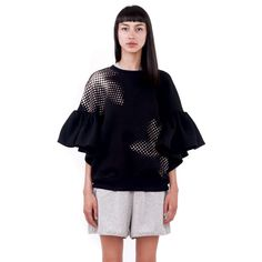 Ioana Ciolacu Daisy Black Sweatshirt is a loose cropped fleece sweatshirt with a placement screen printed front and back graphic and ruffle sleeves. Ruffle Sleeve, Daisy, Bell Sleeve Top, Suit Jacket, Style Inspiration, Sweatshirts, Outfit, Sleeves, Model