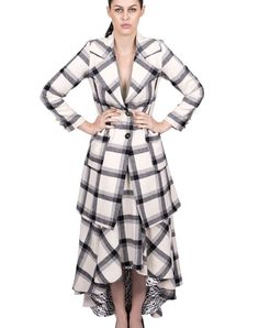 Long Coat - White $469.00  Long coat in white with lapels, pockets and squares print.