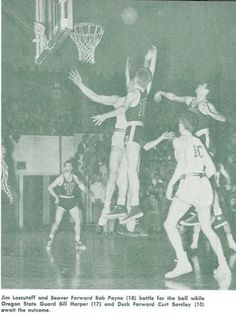 Oregon basketball player Jim Loscotoff fights for a rebound vs. Oregon State 1951. From the 1951 Oregana (University of Oregon yearbook). www.CampusAttic.com