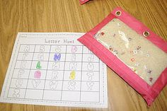 """I Spy"" Bags - Make these using pencil pouches, rice, and poly-beads. The children hunt for letters and record their findings by coloring in the letters on the printable recording sheet."