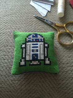 R2-D2 cross stitch pincushion. With Boba Fett on the reverse I can always turn to the Dark Side! Mwah hah haah!