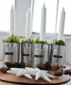 Vintage House: ADVENTSLJUSSTAKE- DIY- Use your labeling gun, get black tape, unlabel some cans  and you have yourself the coolest candleholders. Even if you don't enjoy a lot of steps-- this is easy!