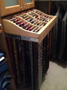 Candlelight Men's Walk In Closet: Close Up View of Pull out Tie Rack