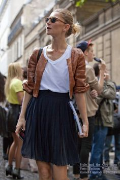 navy pleated skirt with camel leather jacket