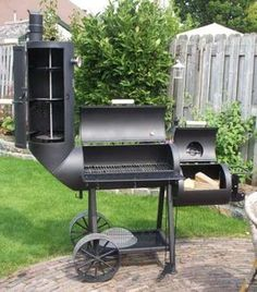 Oklahoma Joe Smoker. .... Why does anyone wait until it is 100 degrees to cook out!!!! Let the smoking begin!!!