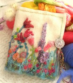 I ❤ embroidery & bead-work . Garden of Delight Needle book - Each book is something totally unique and incredibly beautiful. Tiny stitches, stump work, beads and a button adorn each book.♥ By Fiberluscious Needle Case, Needle Book, Needle Felting, Felt Embroidery, Embroidery Stitches, Embroidery Patterns, Tatting Patterns, Patchwork Quilt, Stitch Book