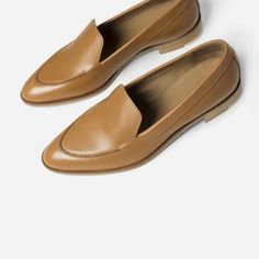 "An elegant, architectural flat that feels as good as it looks  100% Italian leather Hand-polished leather is half chrome-tanned and half vegetable-tanned leather, so it's super soft but still structured Stitching details over the toe ¾"" stacked leather heel, with contrast rubber accent for durability"