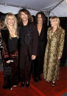 Steven Tyler with his wife (they have since got divorced) And Joe Perry and his wife (still together) 1990