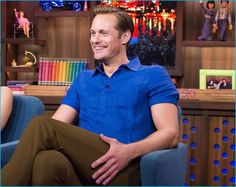 July 2016: Alexander Skarsgård sits in for a taping of Watch What Happens Live, wearing a blue shirt from Orlebar Brown.