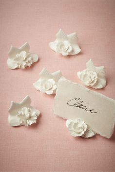Wildbloom Place Card Holders (6) from BHLDN.  I'm getting married in Hawaii, it would only be appropriate to have floral place card holders.