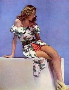 Beachwear by Carven, 1946 color photo print ad floral dress red shorts play suit playsuit day resort wear model magazine designer
