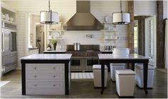 Love this Tracery Interiors kitchen at Lake Martin, AL. Double island, bongo stools, shiplap walls.