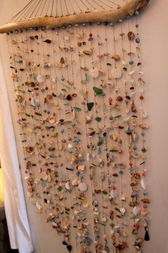 love this. you give kids bits and each makes a strand for this beautiful hanging. I've got stuff and bits. the beach has driftwood.
