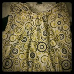Small strapless shirt Strapless yellow small, has black,circle patterns Not Rated Tops Tunics