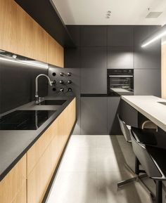 Kitchen Interior Design Compact Krakow Apartment by Hi-Light Architects - InteriorZine - This ultra-modern but cozy apartment designed by Hi-Light Architects is located in Krakow, Poland. The designer Yevhen Zahorodnii searched for a modern Kitchen Room Design, Kitchen Cabinet Design, Modern Kitchen Design, Living Room Kitchen, Home Decor Kitchen, Interior Design Kitchen, Home Kitchens, Interior Decorating, Kitchen Ideas