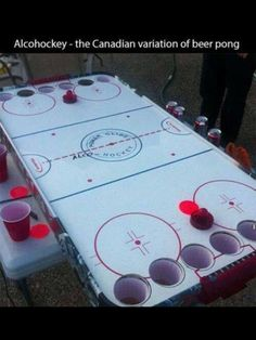 Beer Pong, check. Drinking Cards games, check. Battle Shots, check. Alcohockey. New bucket list drinking game. Cool!!!!