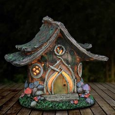 Gardening Diy - The solar wooden fairy house is hand-painted to mimic real wood. The house is adorned with colorful mushrooms and flowers dotted in the grass. Magically illuminates at dusk to delight the fairies and other visitors to your garden. Solar Fairy House, Fairy Garden Houses, Fairies Garden, Fairy Gardens, Clay Houses, Miniature Houses, Miniature Fairies, Miniature Gardens, Garden Figurines