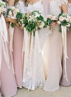 The ribbons look lovely with these mismatched bridesmaid dresses | Brides.com