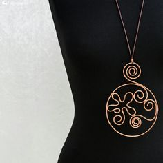 Large copper pendant with spirals and flower in detail