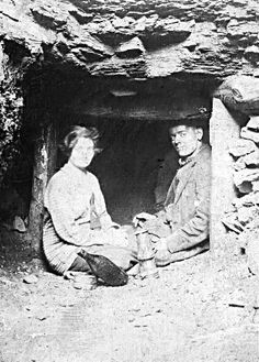A Welsh coal miner: Iorwerth Jones and his cousin Annie May Morris at the entrance to a privately (family) worked 'level' during the 1920s. Above Cwmparc, Rhondda, S. Wales.