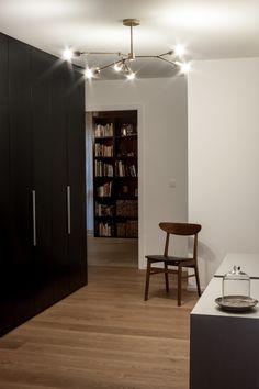 Remodeled modern home in Switzerland / Vintage Farstrup dining chair / Brass chandelier by Parkstudio LA / MDF Italia cases / Woodenfloor Mandorla by Bauwerk