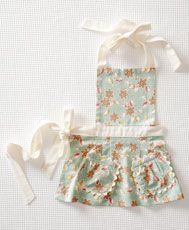 I always like the idea of a basic ruffled dress and different aprons to wear over it every day. This one is proving it an awesome idea.