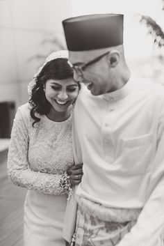 Bride and groom laughing on their wedding day // Andy and Hanis' wedding celebrations began with a Bollywood-themed henna night, and was followed by a traditional 'akad nikah' (or wedding solemnisation) and two receptions.