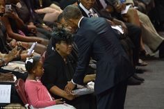 Special moment: Obama greeted Jennifer Pinckney, the pastor's widow, and his daughters