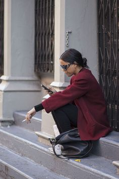 Try wearing #burgundy this Fall! Love how she wore the color on her #coat. For more #StylingTips, visit us at StylingOn.com