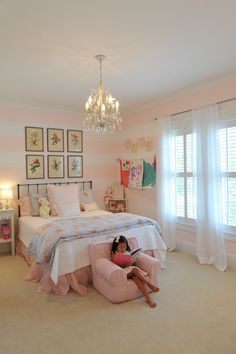 The Girly Big Girl Room, soft pink and white stripes on walls, chandelier, botanical art for a little girls room
