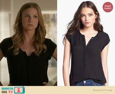 Emily's black button front top on Revenge. Outfit Details: http://wornontv.net/21448 #Revenge