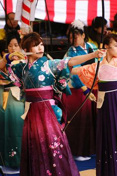 kyudou-japanese archery. There's so much wonderfulness in this photo. Beautiful kimono with women's hakama on several ladies. You can see a bit of the archery pad for women on the lady to the right.