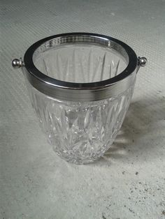 Small glass ice bucket with a crome handle. A great quality vintage piece, and a great item to have at the table or at the bar.  Thick heavy pressed glass that has the quality and apperance of a cut crystal version. Condition is good no damage or chips,and nice clean crome work.  Weight = 1000g H = 13cm dia = 11cm  Please see more at http://www.etsy.com/fr/shop/frenchantiquesalvage