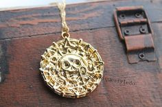 The pirates gold coin necklace Pirates of the Caribbean jewelry gift on Etsy, $3.40