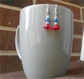 Patriotic Blooms Red bell flowers and white and blue glass and acrylic beads. Blue Swarovski crystal bead for the flowers center. Silver fish hook earrings. Price: $6.00