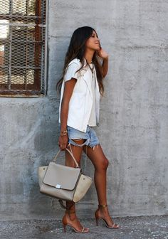 21 Stylish Ways To Wear A Plain White T Shirt - chic white leather vest over a white t-shirt, worn with ripped baggy denim shorts + ankle strap sandals