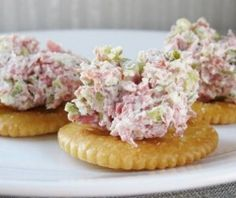 16 oz cream cheese, softened  12 oz deli-sliced ham, chopped  16 oz baby dill pickles, drained, diced  Ritz crackers  In a large mixing bowl, combine cream cheese, chopped ham, and diced pickles; mix well.  Place mixture in the refrigerator for 1 hour, before serving.  Serve chilled, with crackers.