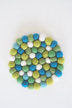 Handcrafted colorful felt trivet. Perfect for a center piece on any table.    Measures 7 inches in diameter.   Felt Ball Trivet by Aveva. Home & Gifts - Home Decor - Dining - Table Accessories Wisconsin