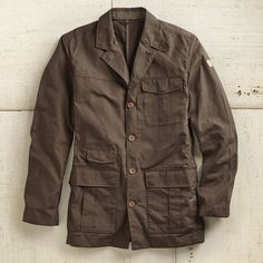 For Him: This breathable travel blazer resists both water and wear, and is light enough to carry around wherever he goes.  Waxed Cotton Travel Blazer | National Geographic Store