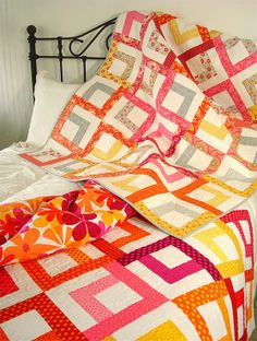 """Spring Colors in Full Bloom - 2 quilts using 2.5"""" strips (jelly rolls)   SpringLeaf Studios Would need white jelly roll and colored jelly roll"""